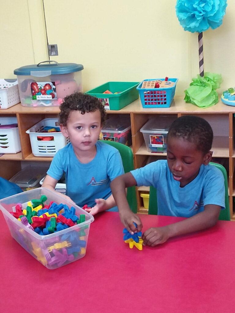 two boys building blocks