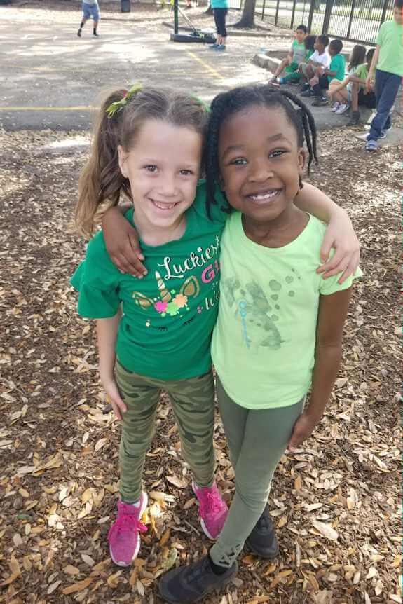 two girls embraced playground