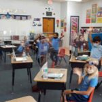 teacher classroom students social distancing