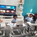 three students virtual learning home