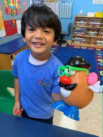 child with potato head